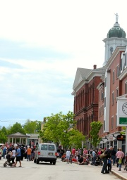 Crowds line the street beside historic Exeter Town Hall